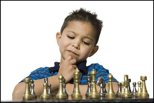Stock Photo: 1660R-9258 Close-up of a boy playing chess