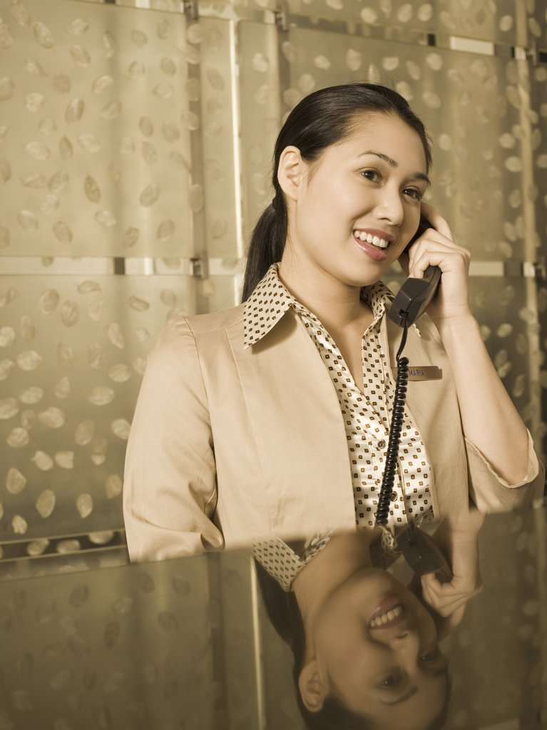 Stock Photo: 1660R-9294 Close-up of a businesswoman talking on the telephone