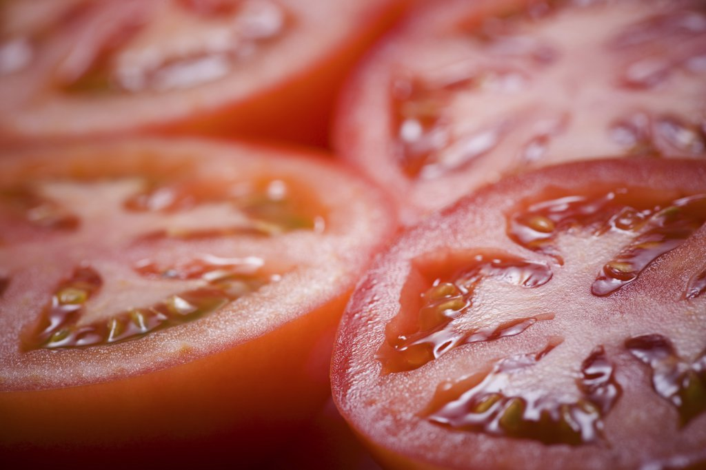 Stock Photo: 1660R-9378 Close-up of four slices of tomato