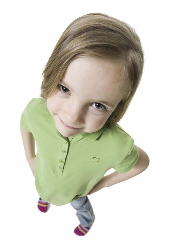 High angle view of a girl standing with her hands on her hips : Stock Photo