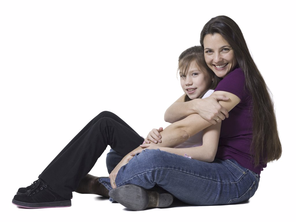 Portrait of a woman hugging her daughter : Stock Photo