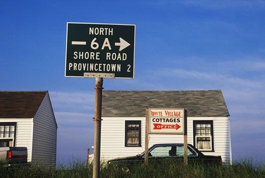 Stock Photo: 1663R-10005 Sign board in front of a cottage, Cape Cod, Massachusetts, USA