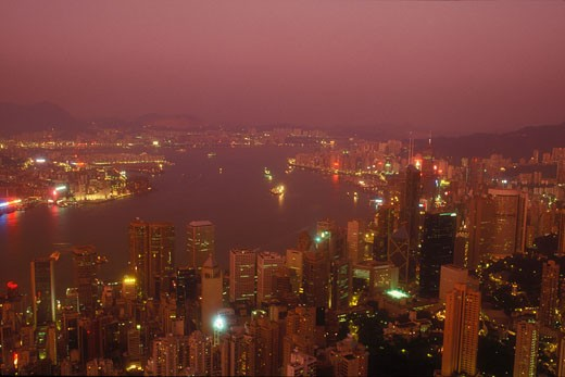 High angle view of buildings in a city lit up at night, Hong Kong, China : Stock Photo