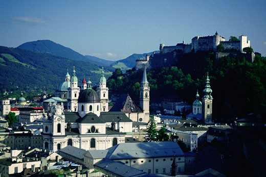 High angle view of a cathedral with a fort on top of a hill, Kollegienkirche, Hohensalzburg Fortress, Salzburg, Austria : Stock Photo