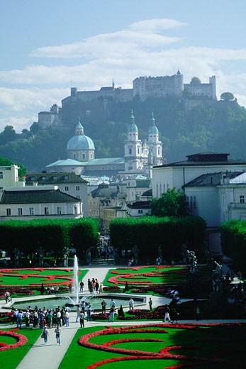 Stock Photo: 1663R-11266 High angle view of tourist in a garden, Rose Garden, Kollegienkirche, Salzburg, Austria