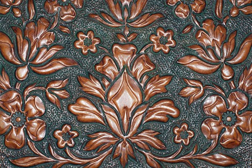 Close-up of a floral pattern carved on a wooden surface : Stock Photo