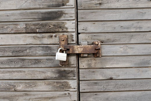 Close-up of a locked wooden door : Stock Photo