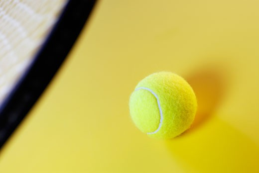 Close-up of a tennis ball and a tennis racket : Stock Photo