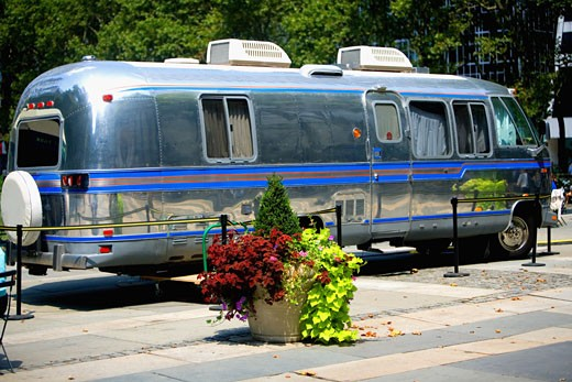 Potted plant near a motor home : Stock Photo