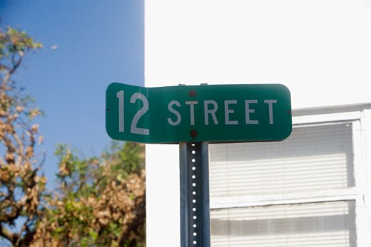 Close-up of a street name sign : Stock Photo