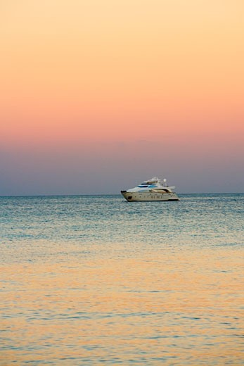 Yacht in the sea at dusk : Stock Photo