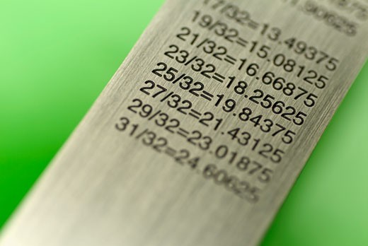 Close-up of a ruler with a conversion table : Stock Photo