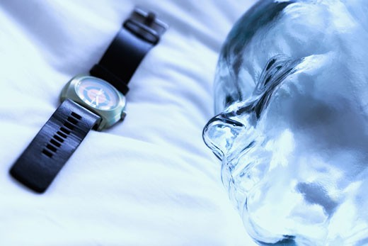 Close-up of a wristwatch with a glass statue : Stock Photo