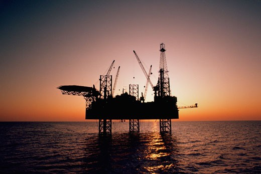 Oil drilling platform in the Mediterranean  : Stock Photo