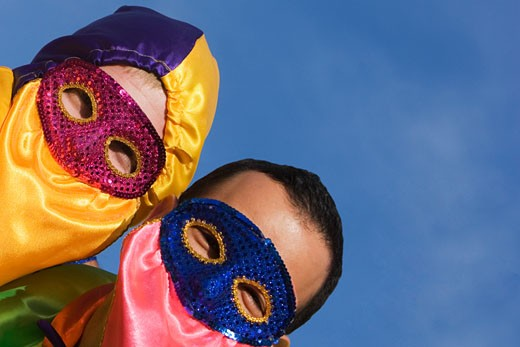 Close-up of two men wearing costumes : Stock Photo