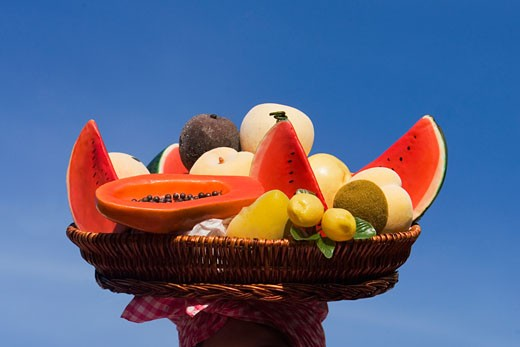 Close-up of assorted fruits in a wicker basket : Stock Photo