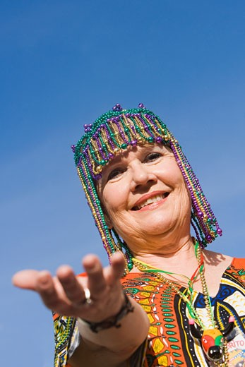 Stock Photo: 1663R-15168 Portrait of a senior woman wearing a beaded headdress and smiling