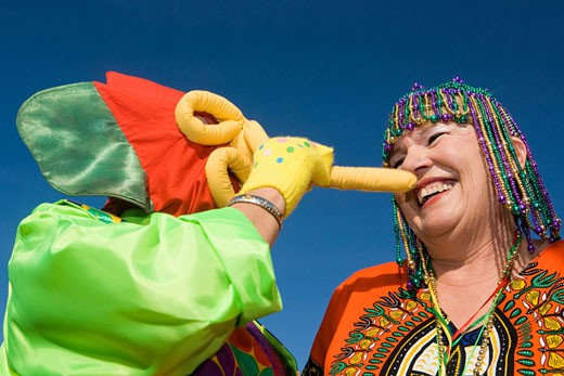 Low angle view of a senior woman wearing beaded headdress and looking at an another woman : Stock Photo