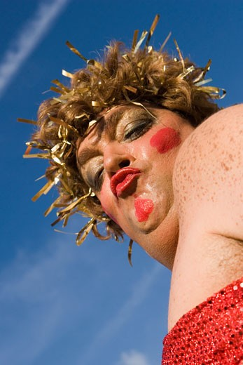 Low angle view of a mature man wearing a costume and puckering his lips : Stock Photo