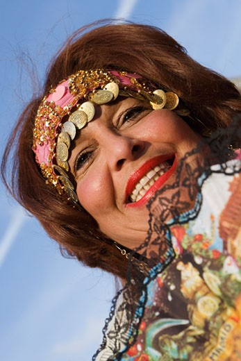 Low angle view of a mature woman smiling : Stock Photo