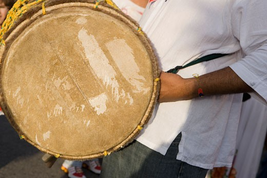 Stock Photo: 1663R-15189 Mid section view of a man holding a drum