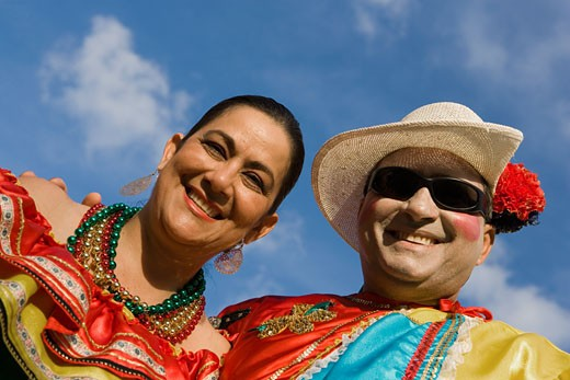 Stock Photo: 1663R-15191 Low angle view of a mature couple wearing costumes and smiling