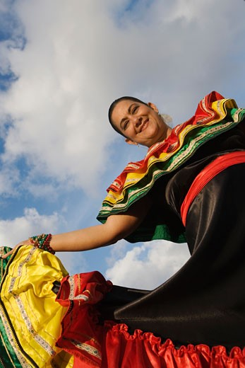 Stock Photo: 1663R-15196 Low angle view of a mature woman wearing a costume and dancing
