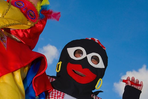 Low angle view of two people wearing masks : Stock Photo
