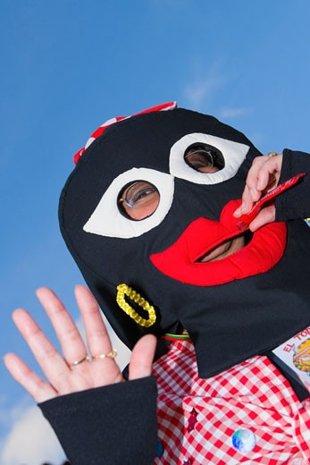 Low angle view of a person wearing masks : Stock Photo