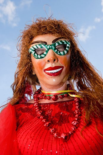Low angle view of a woman wearing a carnival mask : Stock Photo