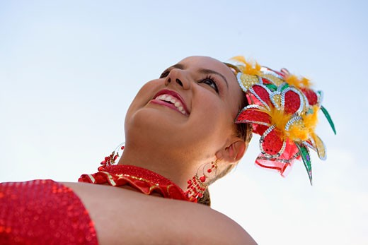 Low angle view of a teenage girl wearing a costume in a traditional festival : Stock Photo