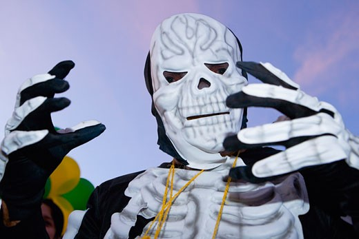 Low angle view of a man wearing a costume and a mask : Stock Photo