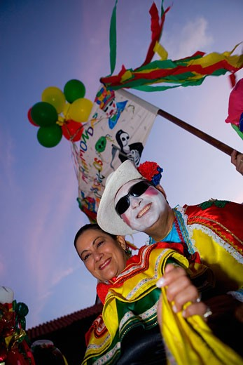Low angle view of a mature couple wearing costumes and smiling : Stock Photo