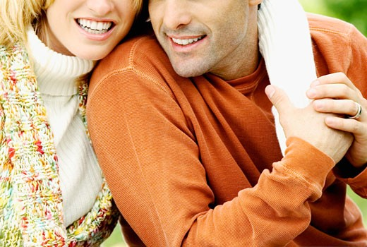 Mid section view of a mid adult couple : Stock Photo