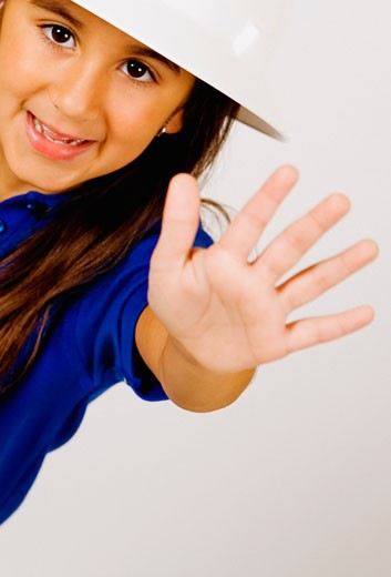 Stock Photo: 1663R-15908 Portrait of a girl making a stop hand gesture