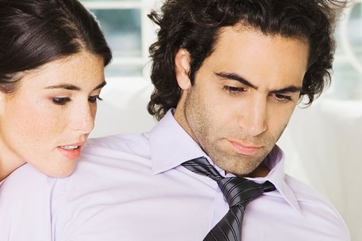 Close-up of a businessman and a businesswoman : Stock Photo