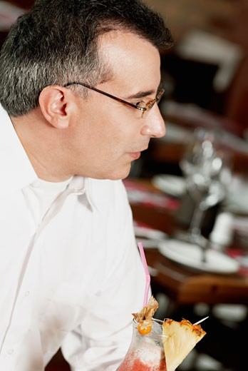 Stock Photo: 1663R-16766 Close-up of a mature man sitting in a restaurant