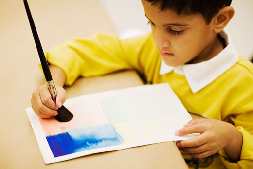 Stock Photo: 1663R-16977 High angle view of a boy painting