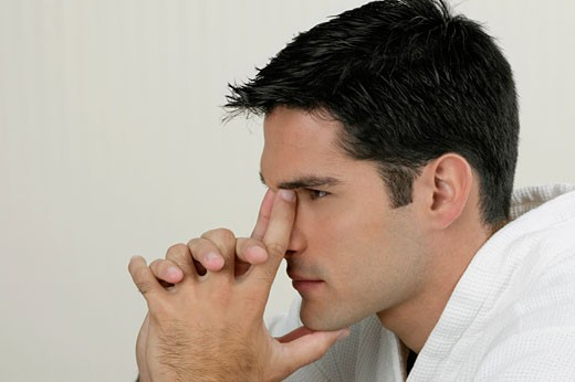 Stock Photo: 1663R-17318 Side profile of a young man looking pensive