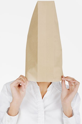 Stock Photo: 1663R-17623 Close-up of a businesswoman covering her face with a paper bag