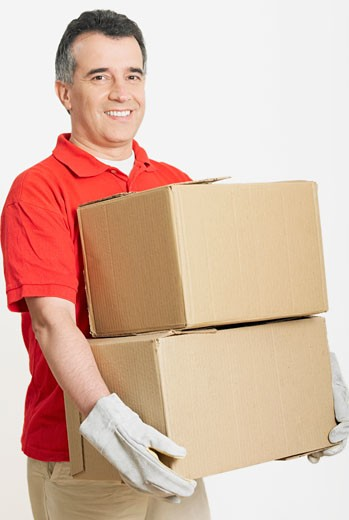 Portrait of a mid adult man holding cardboard boxes : Stock Photo