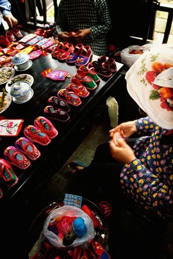 Stock Photo: 1663R-18816 High angle view of three women sewing baby booties, Zhouzhuang, Kunshan City, Jiangsu Province, China