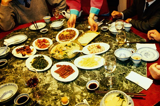 Businessmen at a banquet table, Nanjing, Jiangsu Province, China : Stock Photo