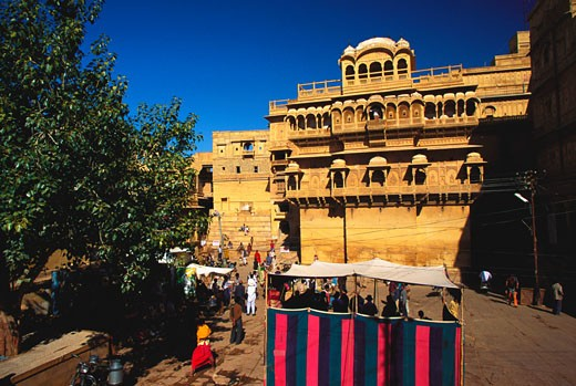 Tourists in a courtyard of a haveli, Haveli Mansion, Golden Fort, Jaisalmer, Rajasthan, India : Stock Photo