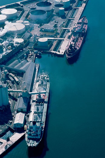 Stock Photo: 1663R-19092 Aerial shot of ships at an oil refinery
