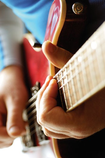 Close-up of man playing acoustic guitar : Stock Photo