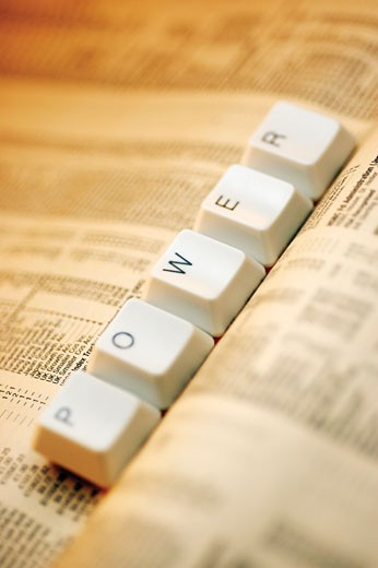 Close-up of computer keys on a newspaper : Stock Photo