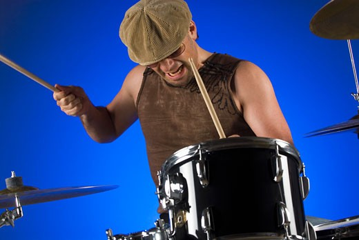 Stock Photo: 1663R-20829 Male drummer playing drums