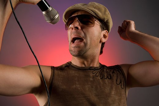 Stock Photo: 1663R-20838 Close-up of a male singer singing