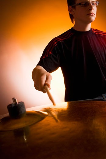 Stock Photo: 1663R-20851 Male drummer playing drums